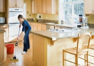 woman_cleaning_kitchen